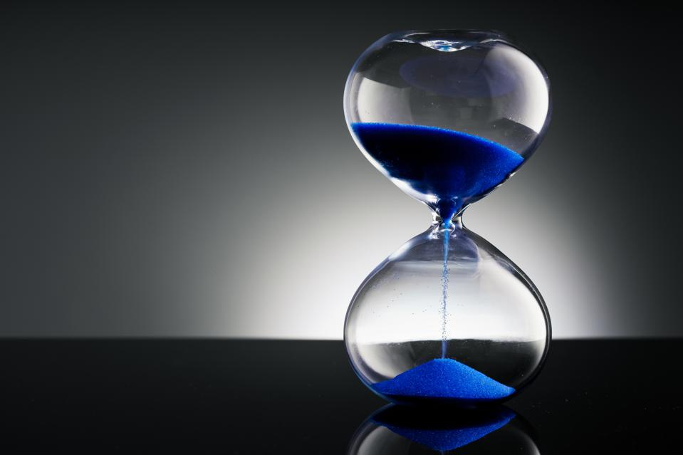 The picture shows an hourglass, representing time.