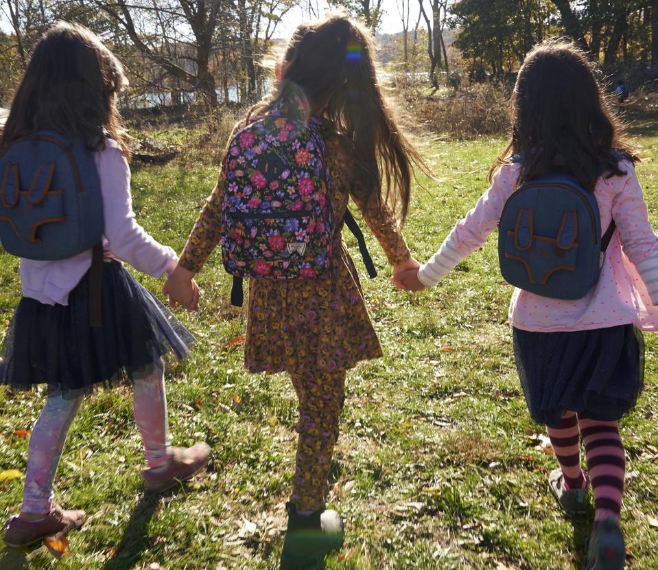 Three children walking back to microschool