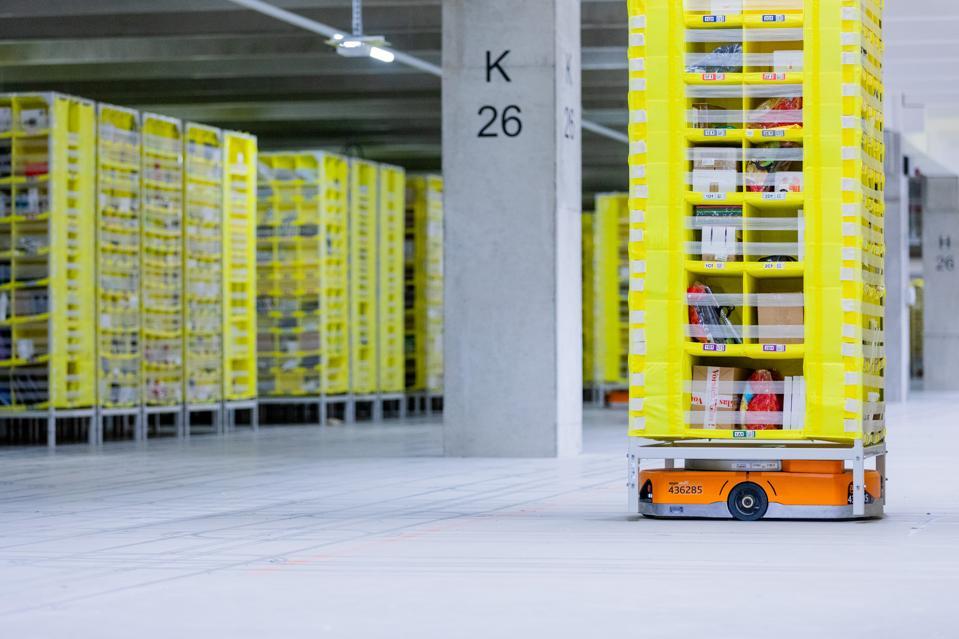 Amazon Robotics robot transports goods in a warehouse.