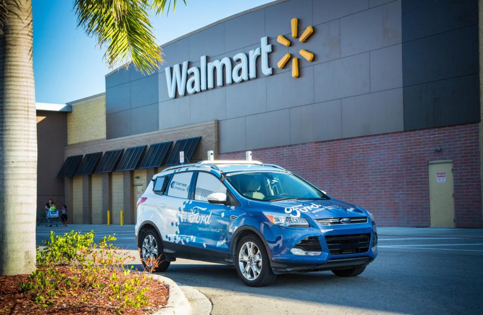 A Ford self-driving vehicle in front of a Walmart store