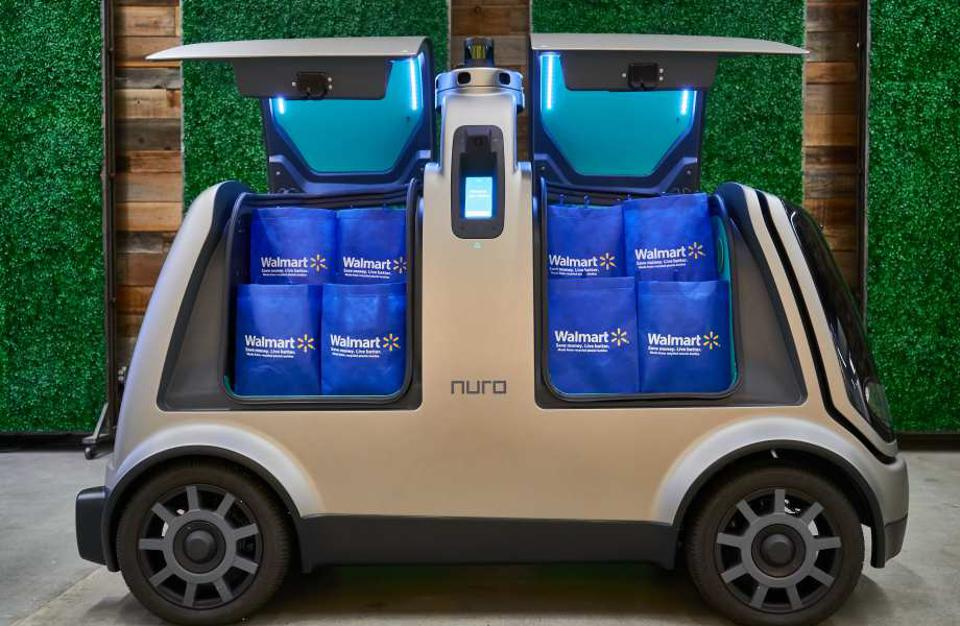 A Nuro self-driving delivery vehicle packed with Walmart shopping bags.