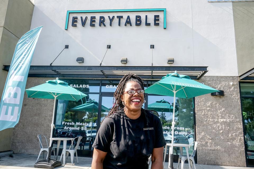 Dorcia Whitebrake in front of Everytable store