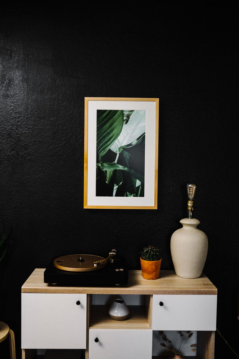 Canvia's realistic art display seamlessly blends with decor like regular wall art and yet changes every day to provide a different mood and interior design themes