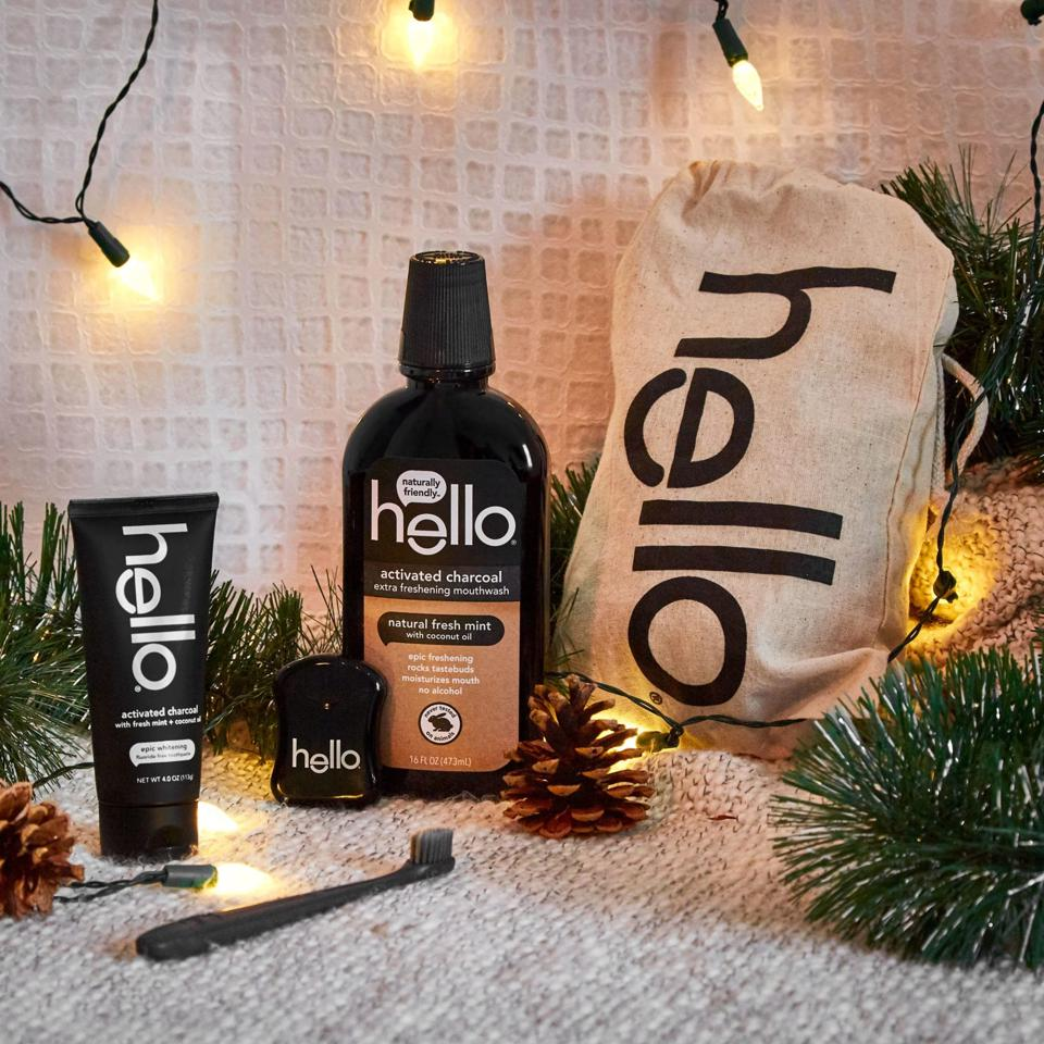 Hello Product's Nice Meets Naughty Holiday Kit featuring the best-selling Activated Charcoal Toothpaste, Mouthwash, Floss, and BPA-Free toothbrush in a reusable canvas bag.