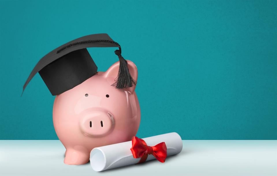 Piggy Bank with Graduation Hat and diploma