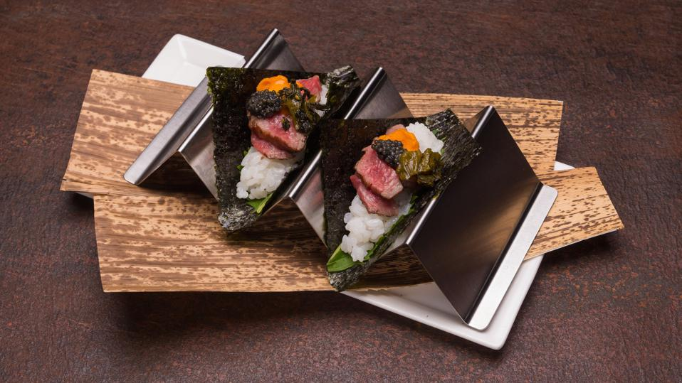 Wagyu hand rolls topped with uni and caviar
