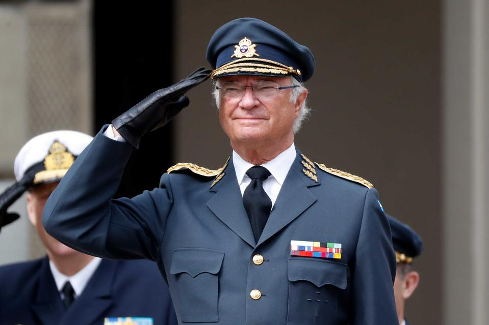 King Carl XVI Gustaf of Sweden salutes at his 73rd birthday celebration in Stockholm.