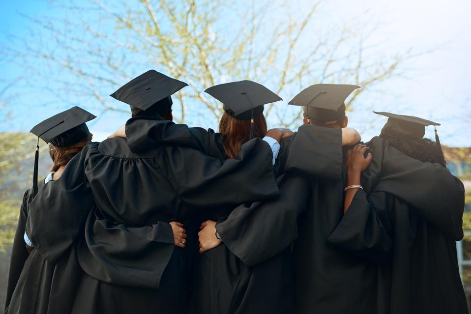 Graduates looking toward a bright horizon.
