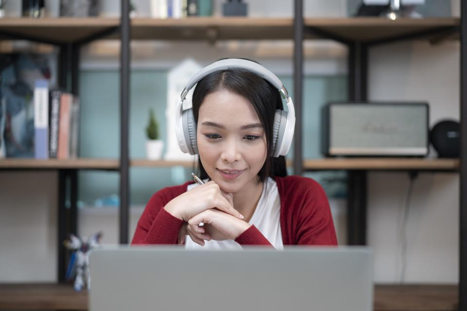 close-up shot of an attractive young businesswoman working with video conference at home