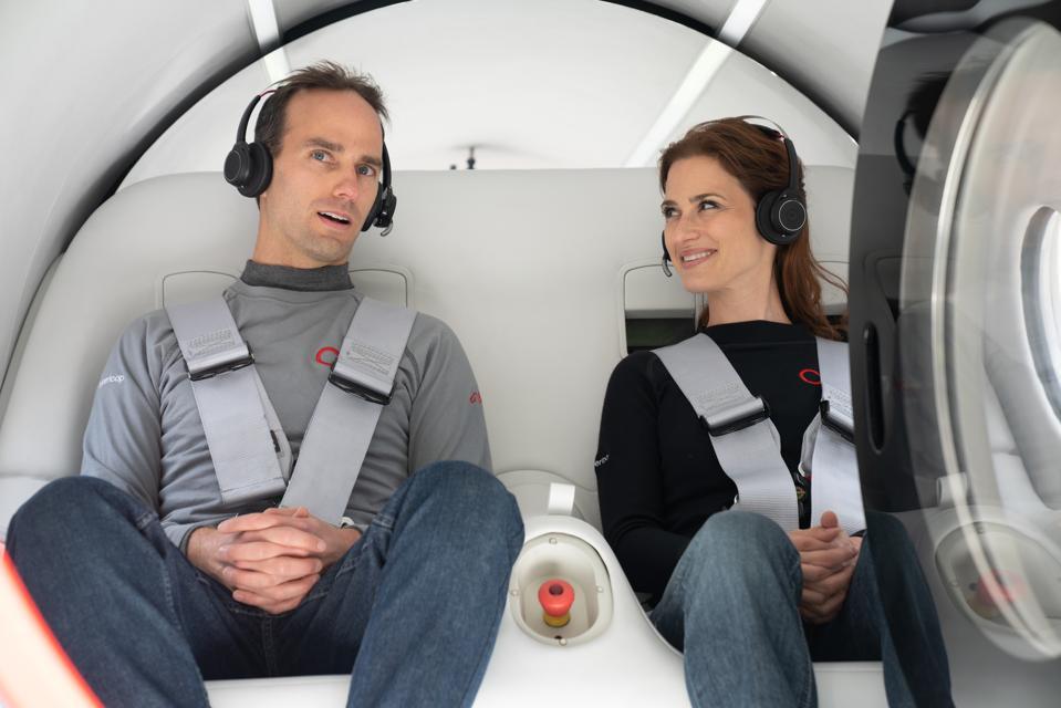 Josh Giegel and Sara Luchian seated in a pod for the Virgin Hyperloop test run.