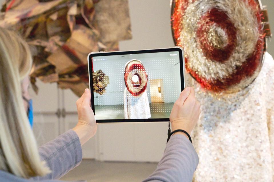 Norton visitors use Norton Art + with Nick Cave's 'Soundsuit' (2010).