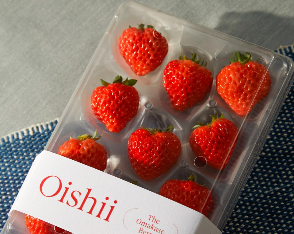 A package of red, ripe, large strawberries