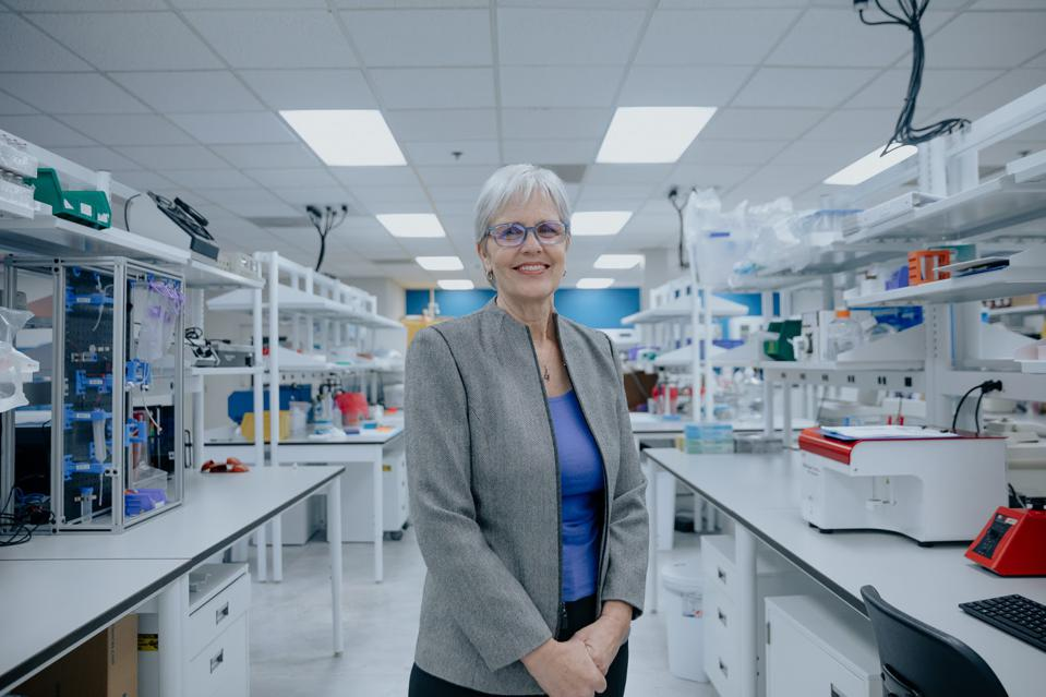 Dr. Patricia Lawson standing in a medical lab