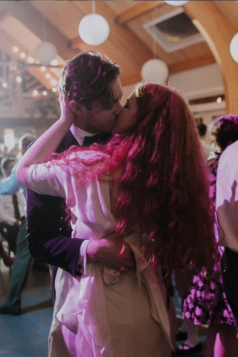 The newlyweds kiss at their wedding.