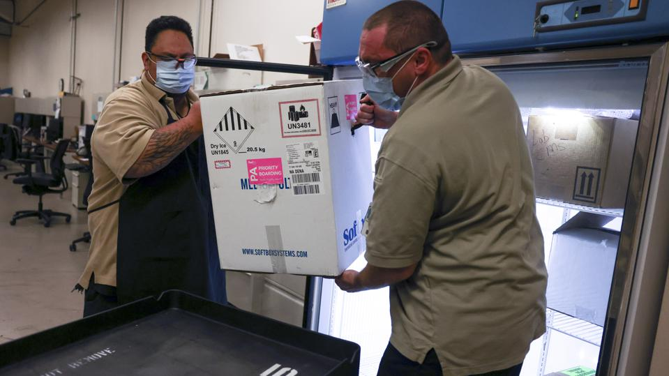 Pfizer vaccines being delivered. The company said Thursday that it has millions of doses but no instructions from the government as to where to ship them.