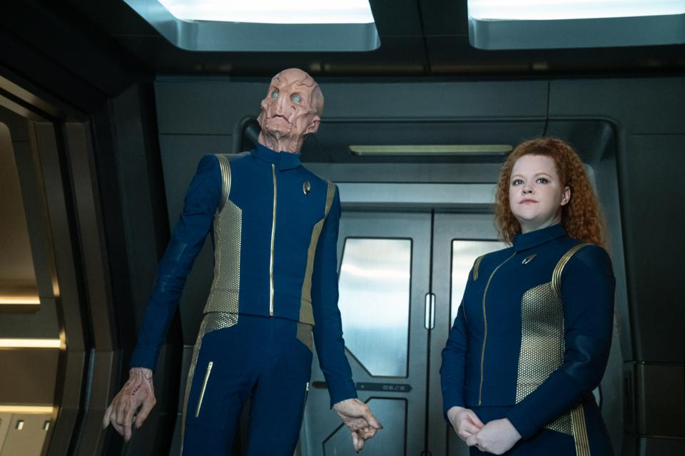 Saru and Wiseman look up at something outside the window of the U.S.S. Discovery.
