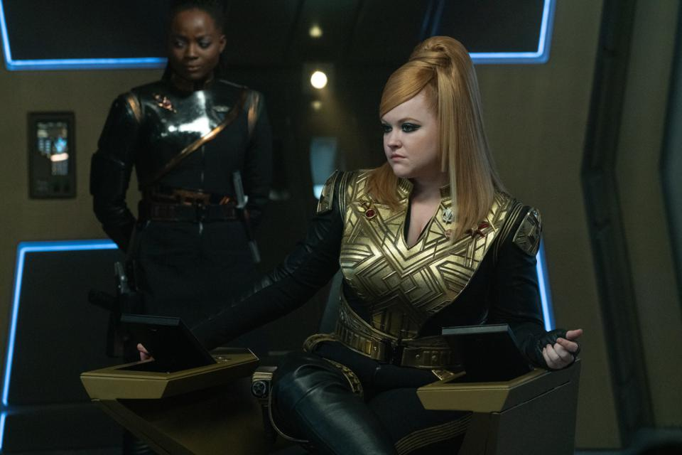 As Joann Owosekun, Oyin Oladejo is usually the navigator aboard the starship, but in the Mirror Universe, she serves as Emperor Georgiou's personal honor guard on the Discovery, captained by Mary Wiseman's character, Capt. ″Killy″ Tilly.