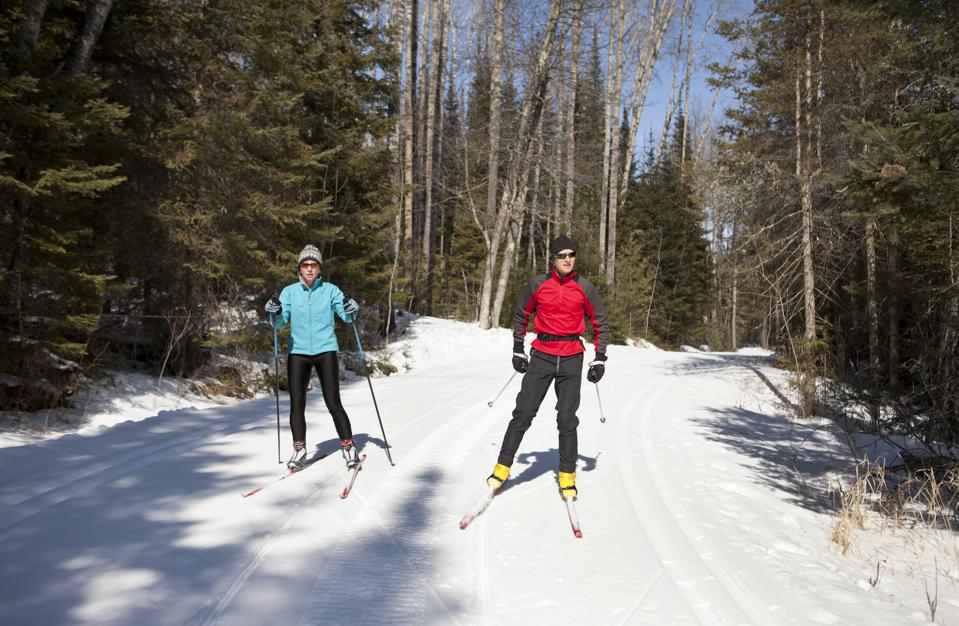 Nordic Skiing Couple Skate Skiing on a Groomed Trail.