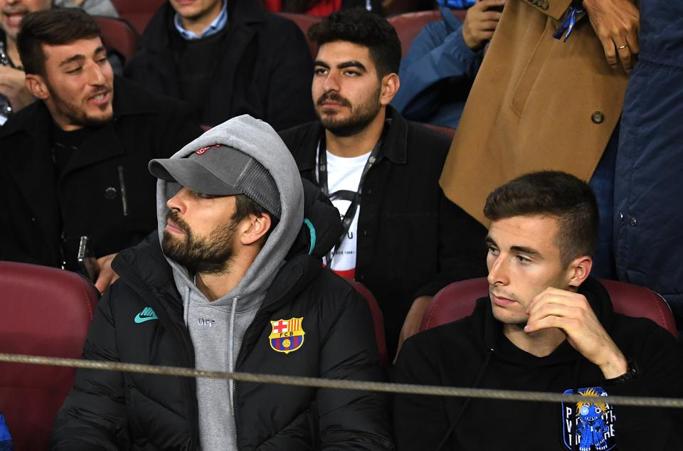 Gerard Pique, seated at Barcelona's Camp Nou stadium.