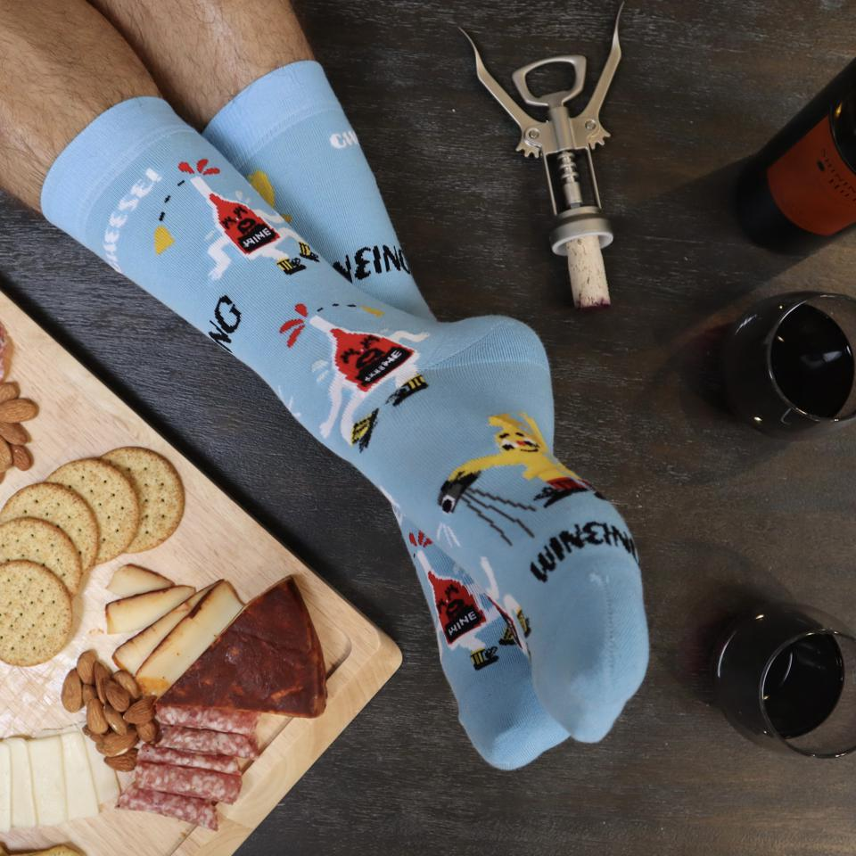 Pop a cork and bring out the brie. Now all you need is these Whine & Cheese socks.