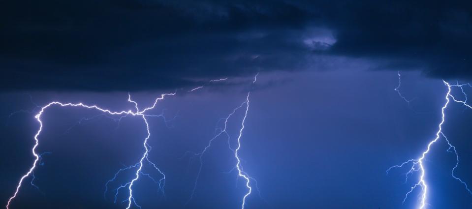 Four lightning bolts illustrate the quadruple whammies awaiting Tesla