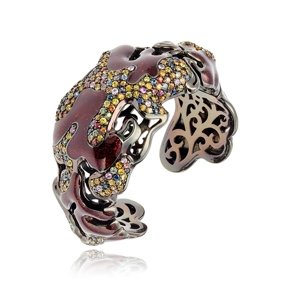 Biomorphic colored sapphire bracelet with hand-applied cold enamel paint design
