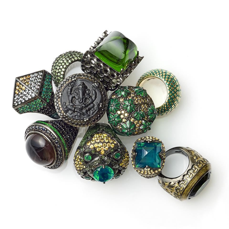 Finely detailed green and yellow sapphire rings abound with botanical details and flourishes.