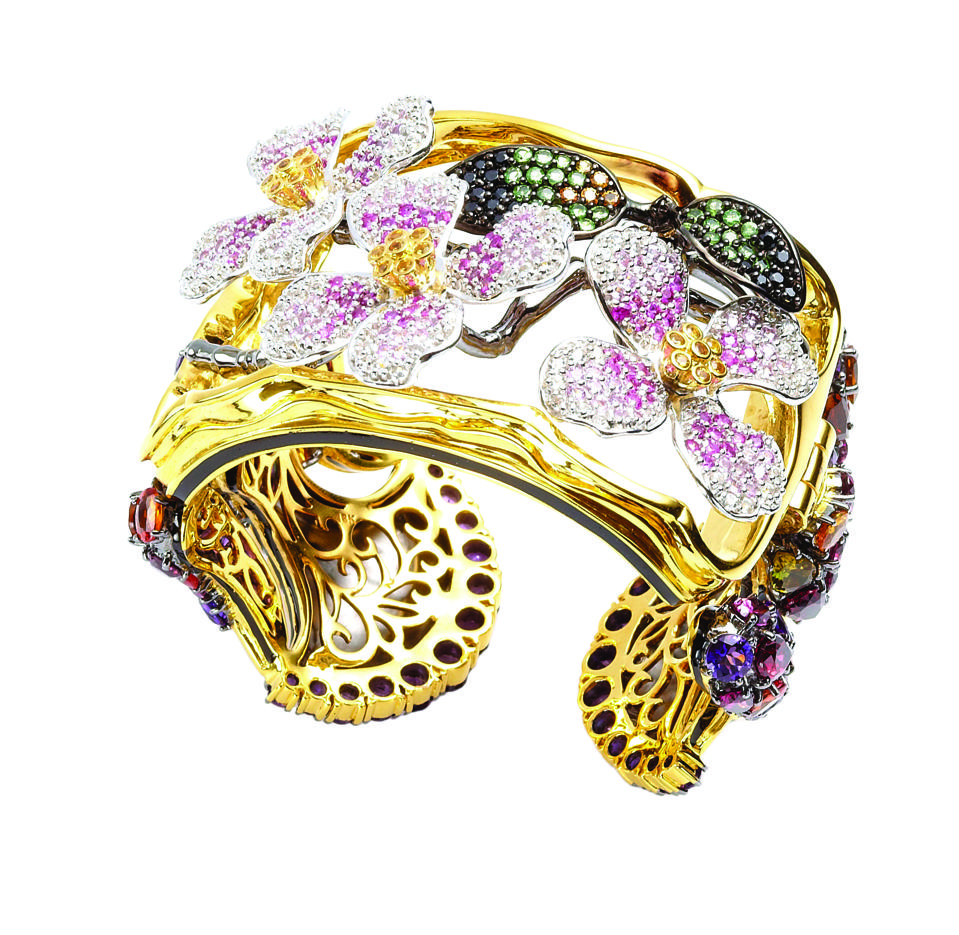 Sensual dogwood flower cuff bracelet in pavé colored sapphires.