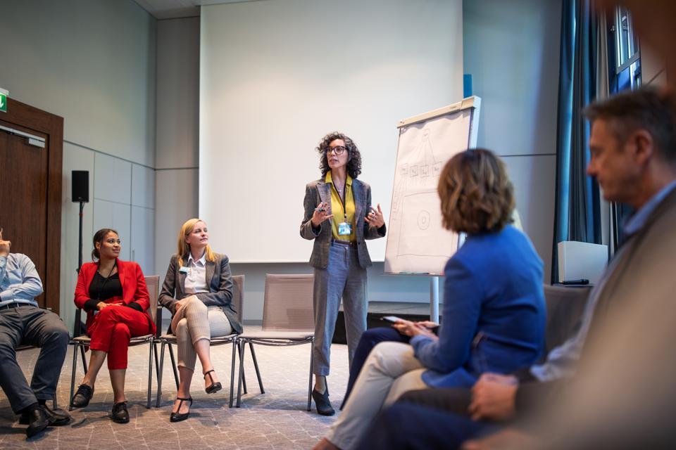 Businesswoman giving presentation during a seminar