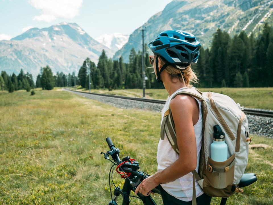 Woman on mountain bike looking at panorama
