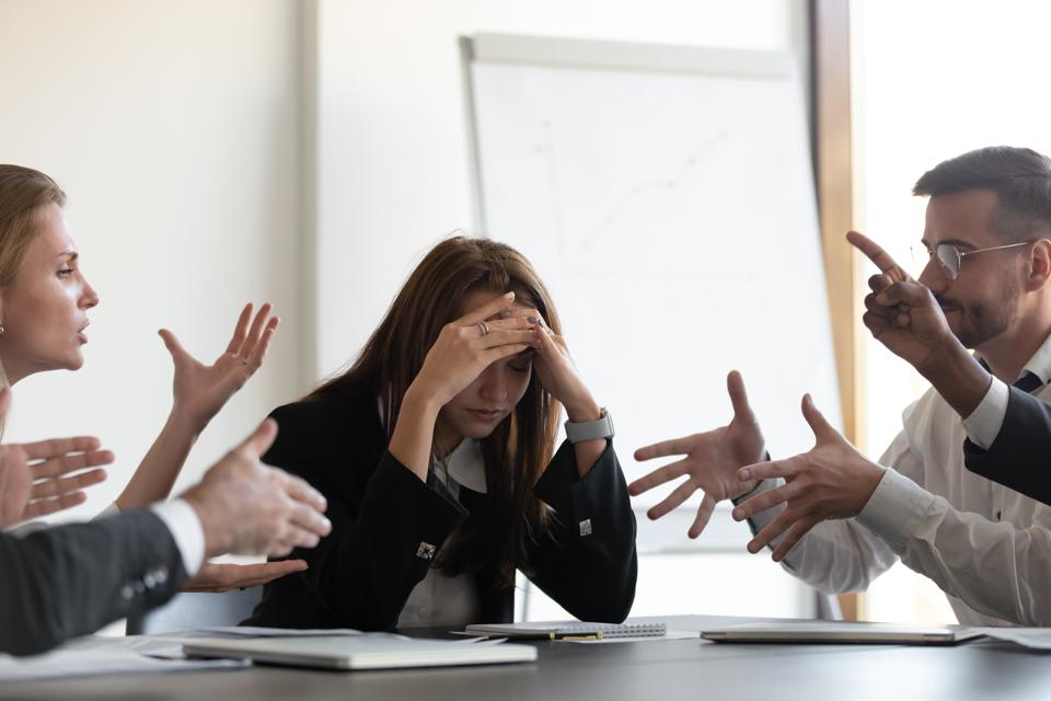 Frustrated millennial female worker felling tired of working quarreling.