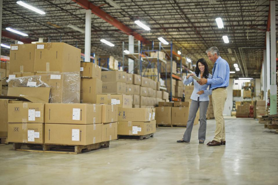 Warehouse owners using tablet pc