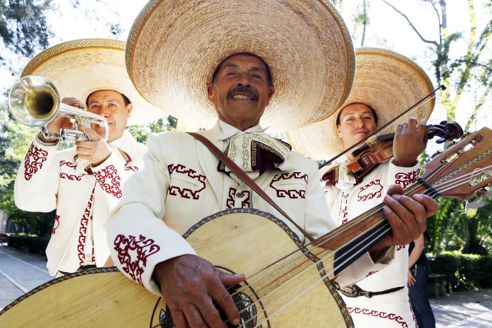 Musicians playing in mariachi band, Mexico.