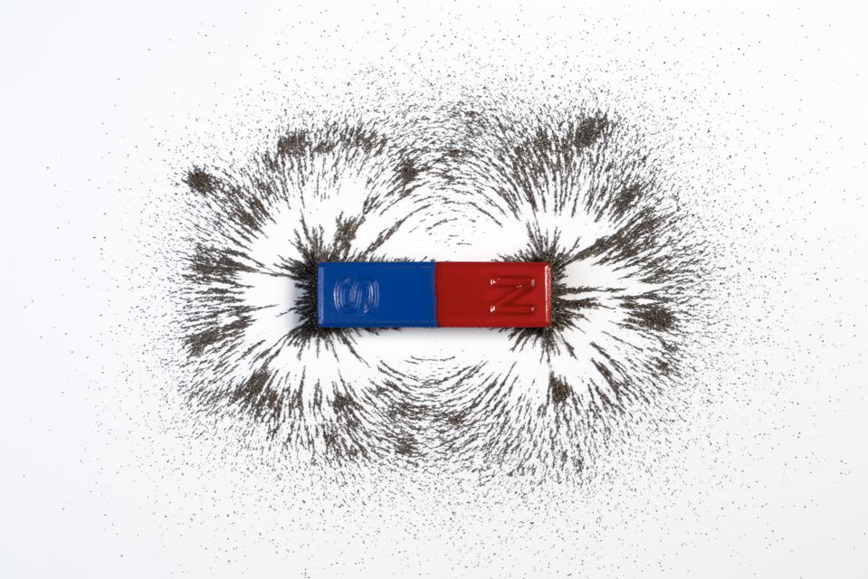 Red and blue bar magnet or physics magnetic with iron powder magnetic field on white background.