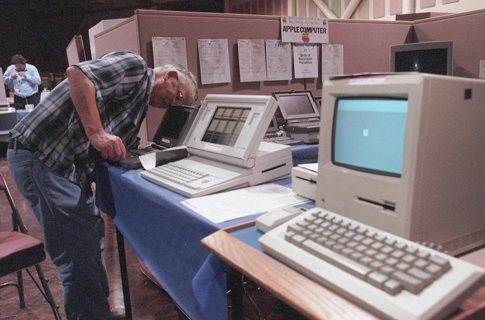 Eugene H. Louie Photograph OldTech  10012000  Paul Zurakowski, 73, (cq name) listens for that familiar sound of a computer booting up at the the fourth annual Vintage Computer Festival  held this weekend in San Jose.  Zurakowski bought his first computer