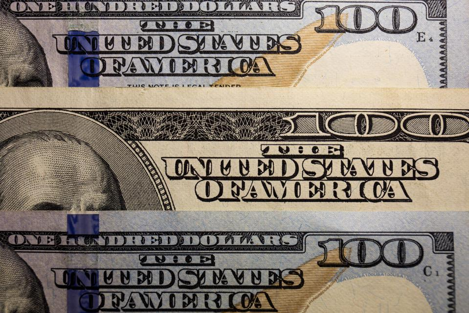 In this photo illustration, United States one hundred-dollar...