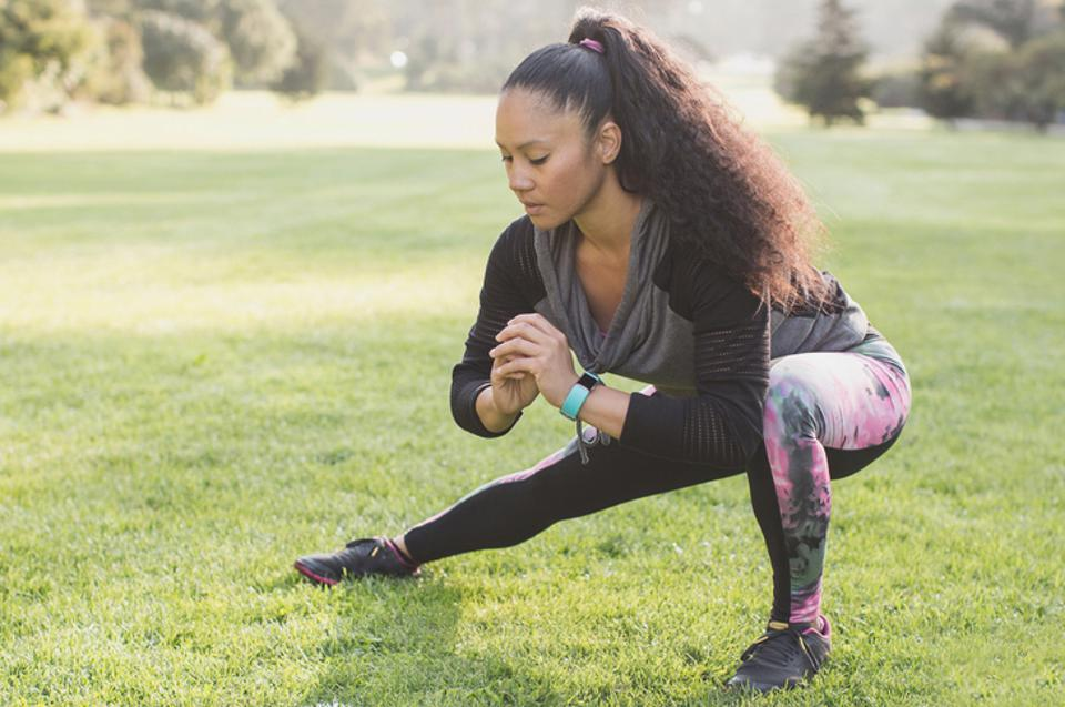 Woman exercising while wearing Fitbit