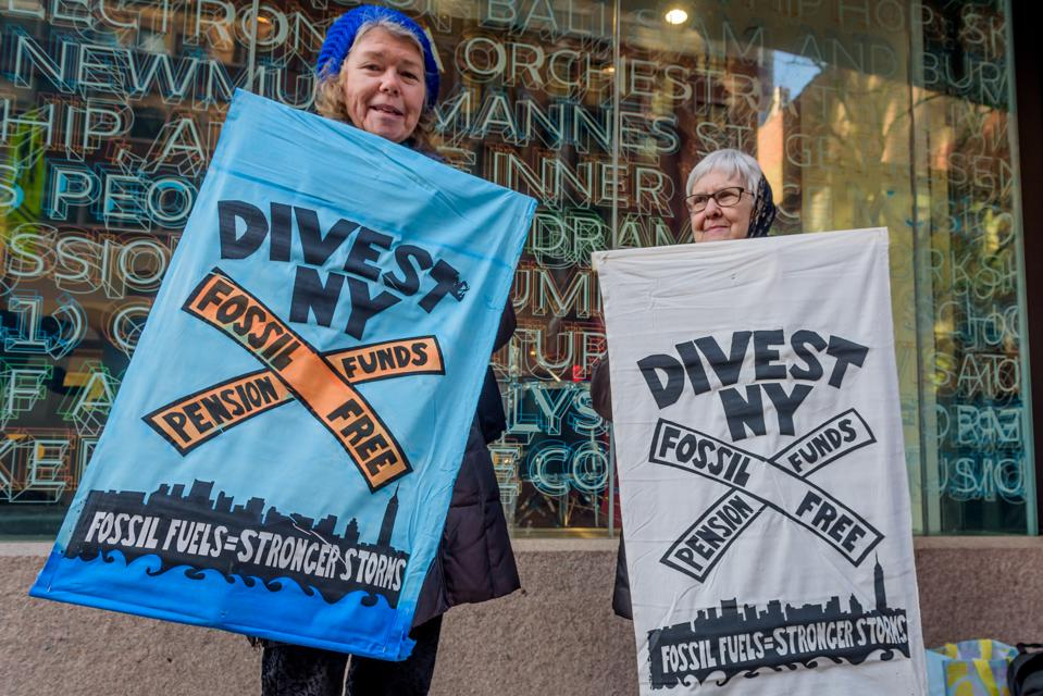 Members of the campaign to Divest New York States pension...
