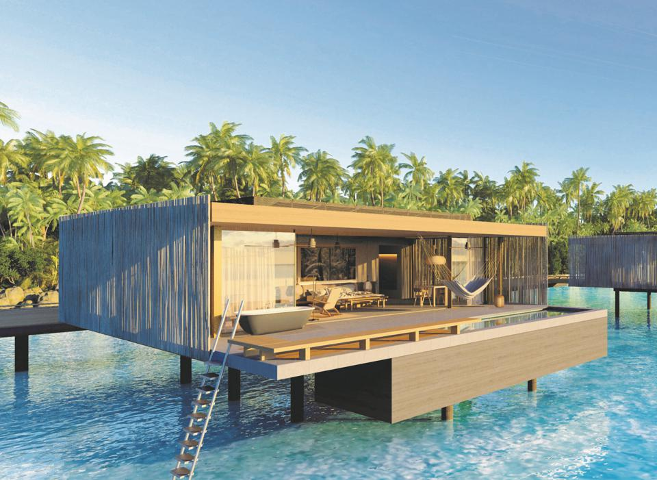 The villas at Patina Maldives hotel are on stilts above the bright turquoise Indian Ocean
