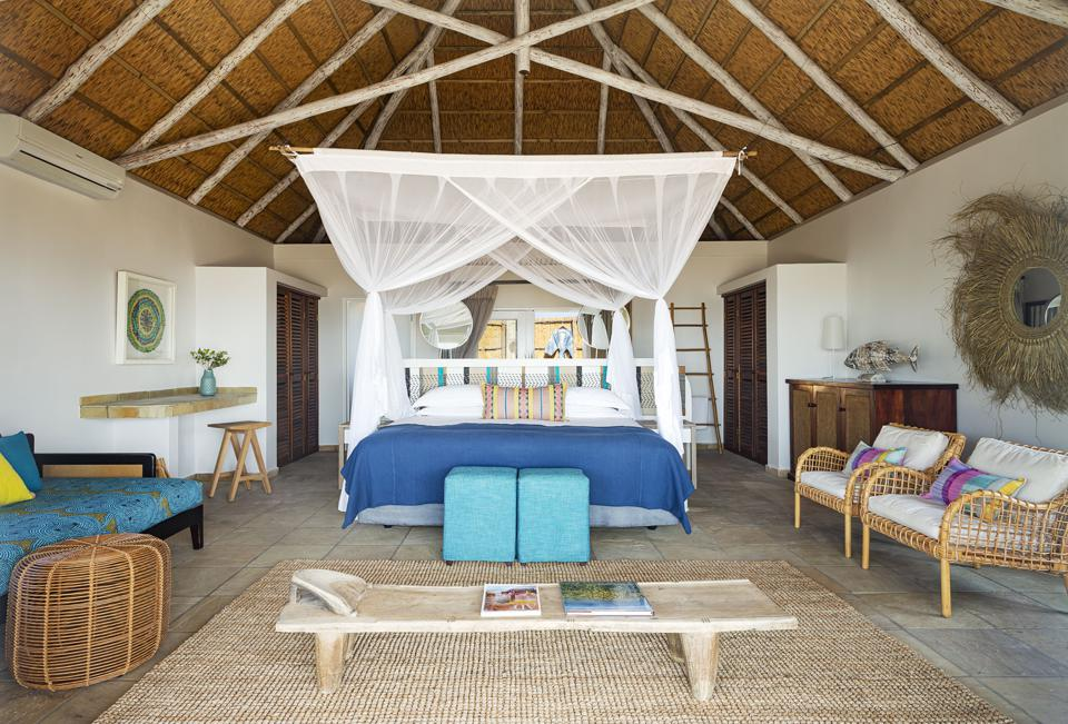 The big rooms at Azura Marlin Beach in Mozambique have a colorful decor and African style