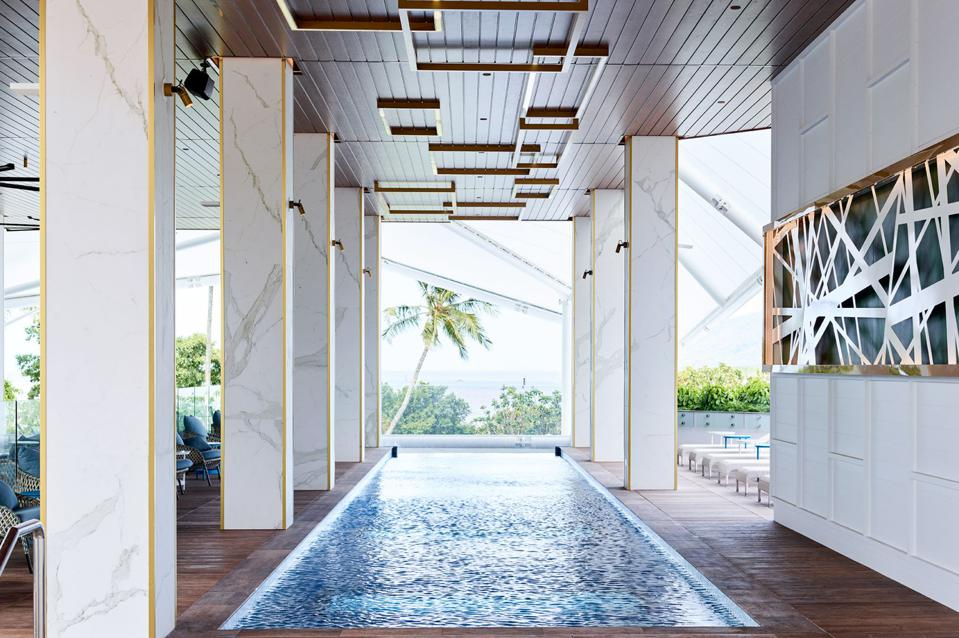 The hotel pool at the Flynn in Cairns, Australia, is within a contemporary enclosure.