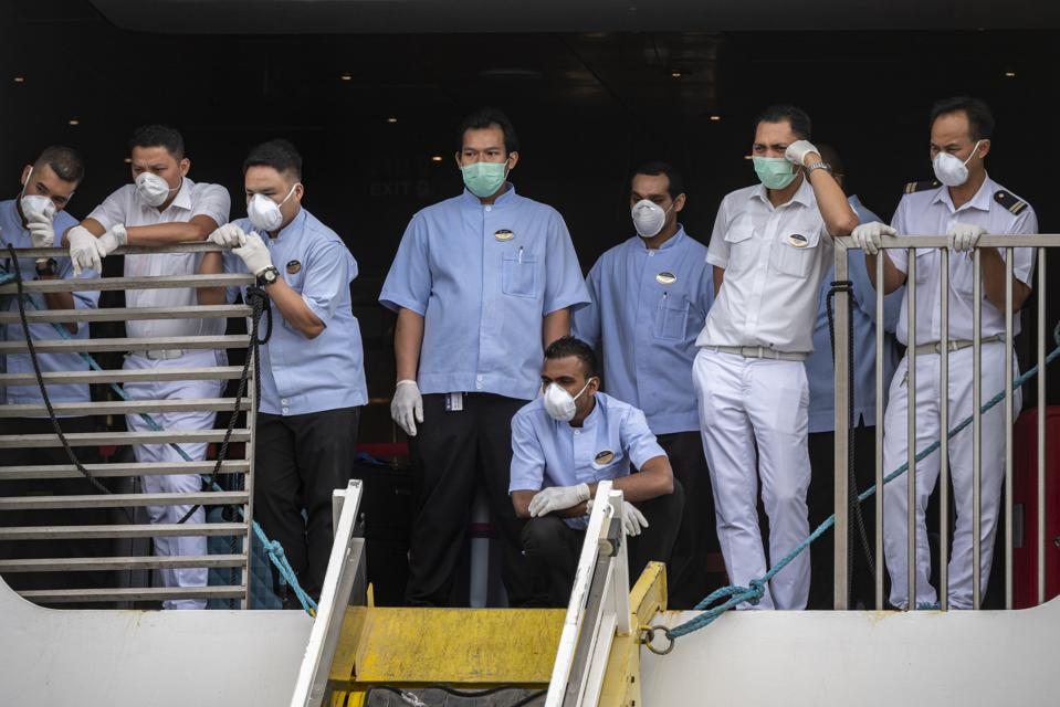 Ship crews were forced to stay on board beyond their legal limits due to the coronavirus Crew Change Crisis.  Seen here crew stuck on MSC Fantasia cruise ship in Portugal.