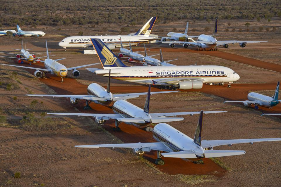 Singapore's large airline fleets, seen here grounded in Alice Springs, Australia due to the coronavirus pandemicSingapore's large airline fleets, seen here grounded in Alice Springs, Australia due to the coronavirus pandemic