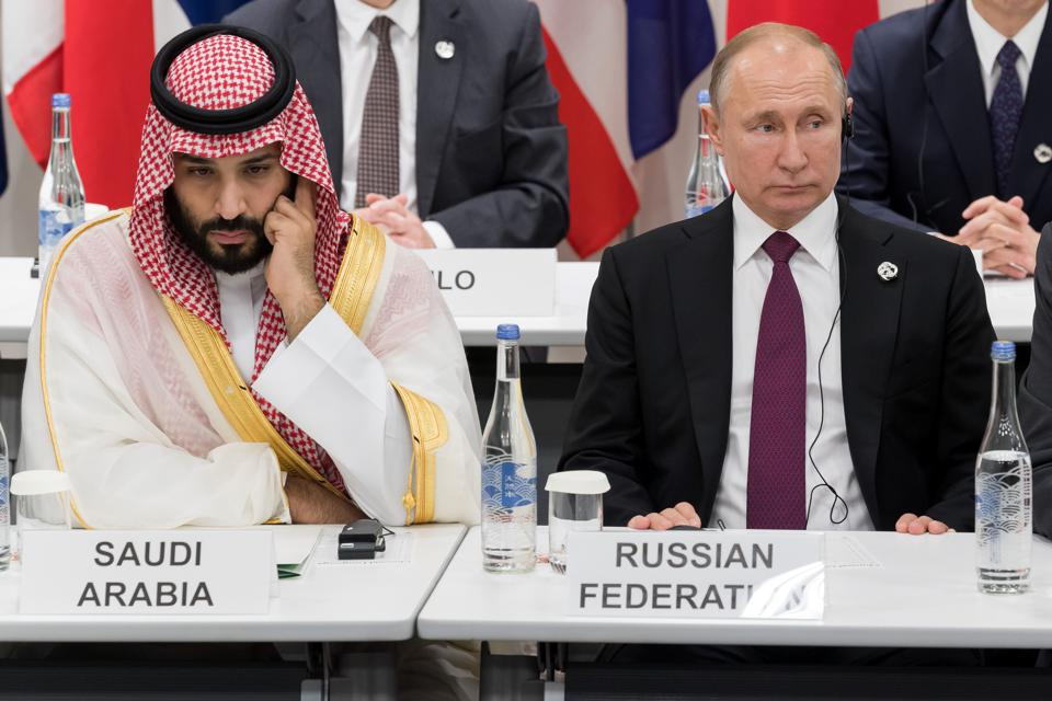 Saudi Arabia's Crown Prince Mohammed bin Salman and Russian President Vladimir Putin would seen be in the midst of an oil price war as the coronavirus pandemic raged.  Seen here in Jun 2019 at the G20 meeting in Japan.
