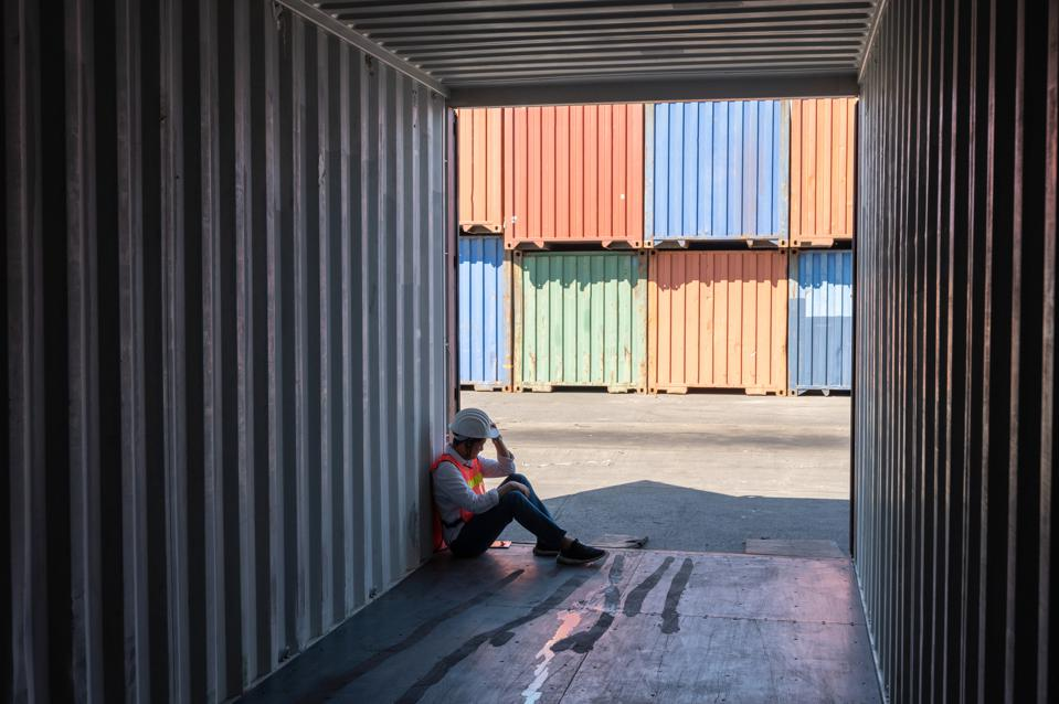 staff worker engineer in logistic business sitting in container box