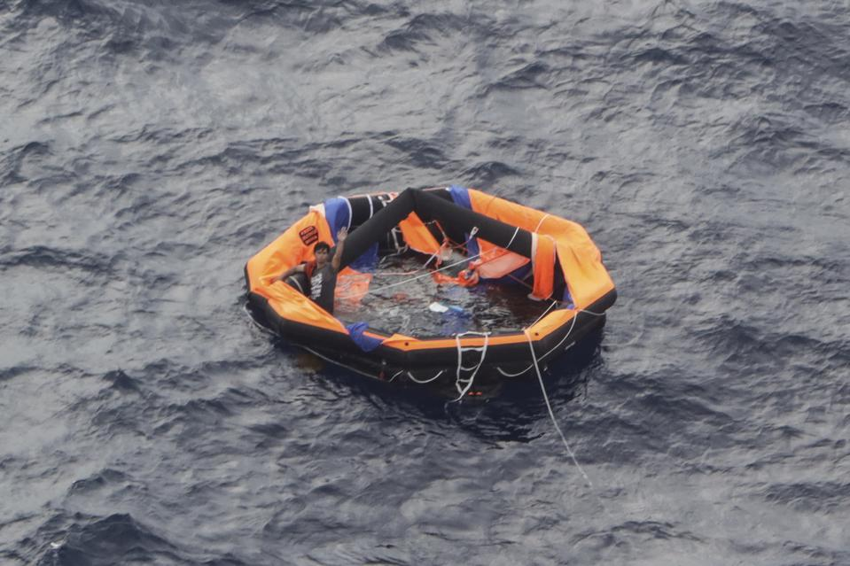 Sep 4: crew from Gulf Livestock 1 waving to be rescued.  Only 2 of the 43 crew survived, and mentioned engine failure as the cause of the sinking in the midst of Typhoon Maysak