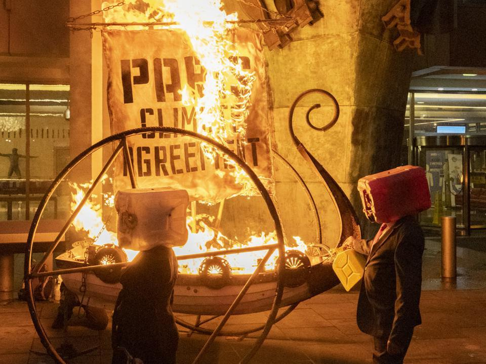 15 Nov: Climate Change activists with Ocean Rebellion set fire to a 'Viking Ship' outside the International Maritime Organization HQ, a day before the virtual meeting of its Marine Environment Protection Committee.