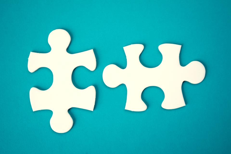 Directly Above Shot Of Jigsaw Pieces Over Blue Background