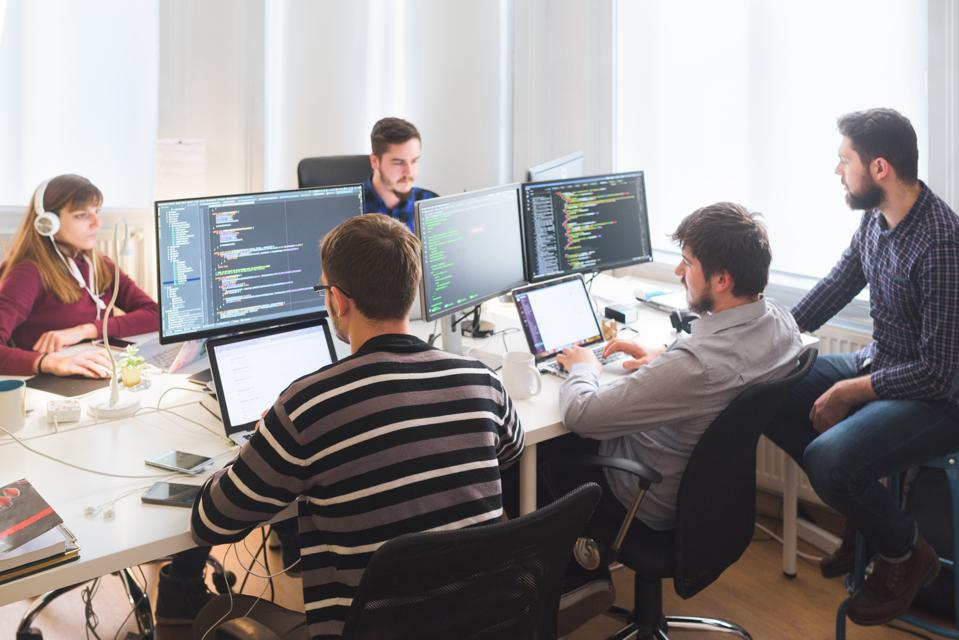 Software developing team working in the office