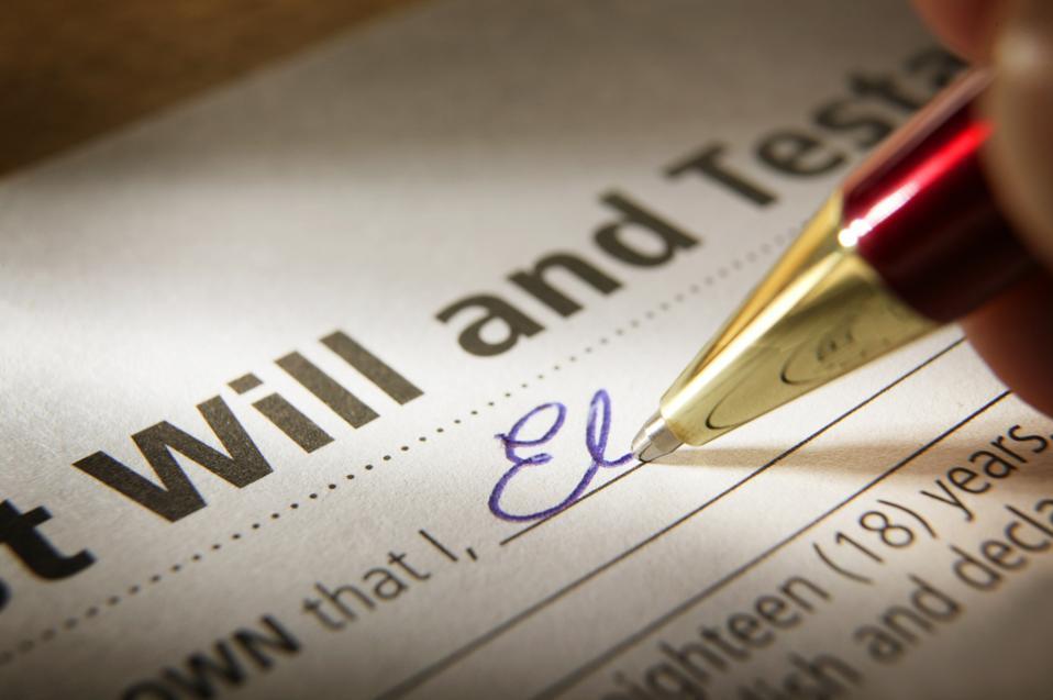 Man Signing Last Will & Testament